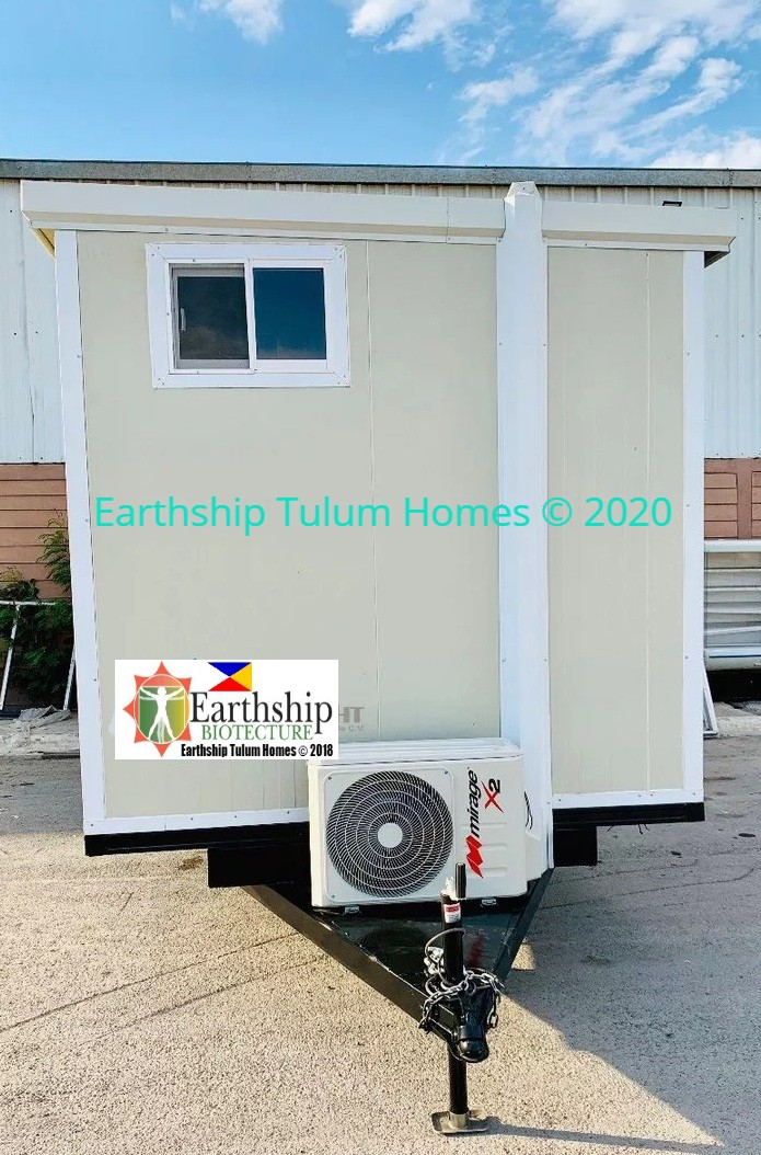 Mobile container equipped with slanted roof, AC, small bathroom, Doors, Windows, and Lighting.