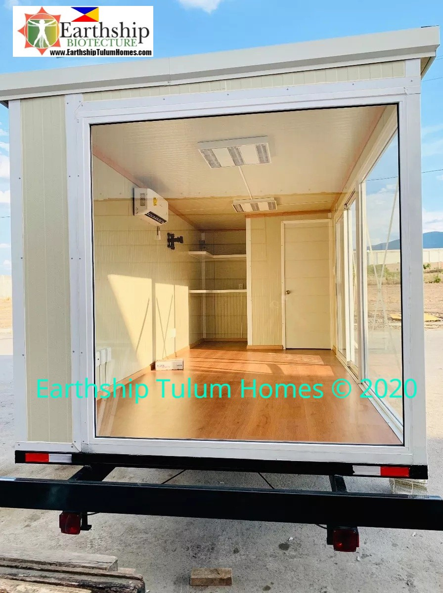 Mobile container equipped with 2.4 m tall slanted roof, AC, small bathroom, Doors, Windows, & Lighting.